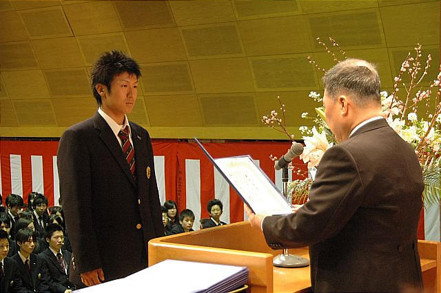 One%20student%20receives%20diploma%20from%20Principal.JPG